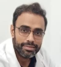 Dr. Karan Manak